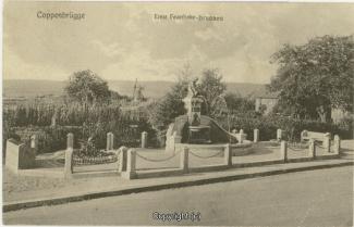 0050A-Coppenbruegge243-Feuerhake-Brunnen-1908-Scan-Vorderseite.jpg